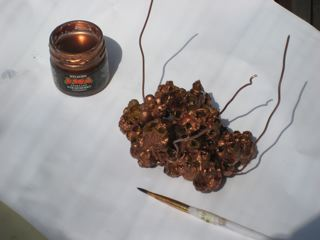 Painting copper conductive coating on bumble bee wax hive